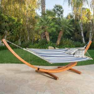 Wood hammock with blue and white striped fabric photo