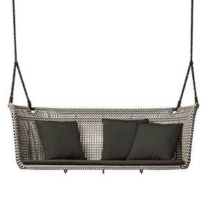 Woven bench swing with throw pillows photo