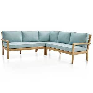 Light blue sectional with a wood base photo