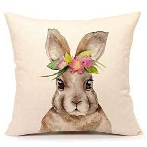 Cream pillow cover with a brown bunny wearing a flower crown on the front. photo