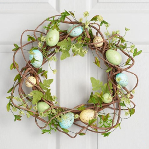 wreath on a white door with branches, leaves, and Easter eggs from World Market photo