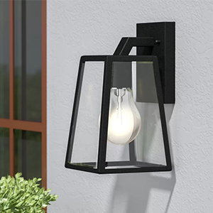 Black boxy wall sconce on an outdoor wall photo