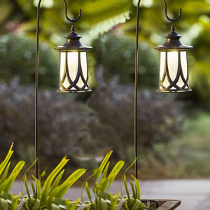 Outdoor lanterns with shepherd hooks from Overstock photo