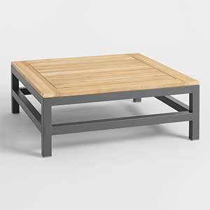 Low-profile outdoor coffee table with wood top and metal base photo