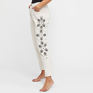 White Embroidered Jeans with Black Tribal-Inspired Detailing on the Side photo
