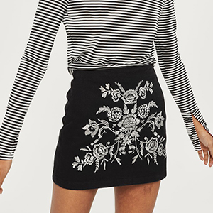 Black Denim Mini Skirt with White Floral Embroidery on the Front photo