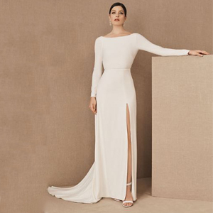 White long-sleeve wedding dress with an open back from BHLDN photo