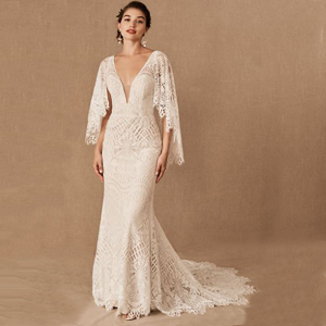 Ivory lace long-sleeve wedding dress with deep neckline from BHLDN photo