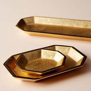 Gold octagonal tray set with three different sizes. photo