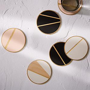 Gold home decor coasters in rose gold, black and gold, white and gold. photo