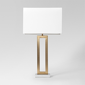 Gold home decor lamp with rectangular cutout center and marble base. photo