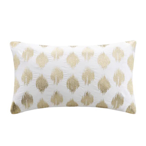 Gold home decor embroidered oblong pillow with ikat pattern. photo