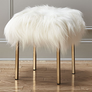 Gold home decor accent stool with sheepskin cushion photo