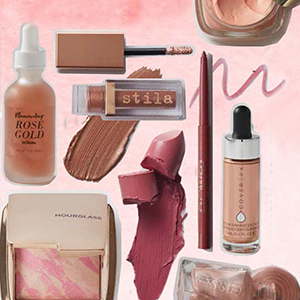 A collection of rose-colored beauty products on a blush background. photo