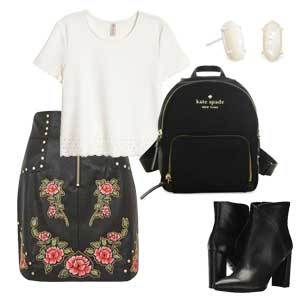Floral leather skirt with a white top, black boots, black backpack, and white stud earrings. photo