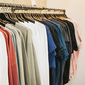 Clothes hanging on a clothing rack. photo
