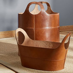 Cognac leather storage basket with handles. photo