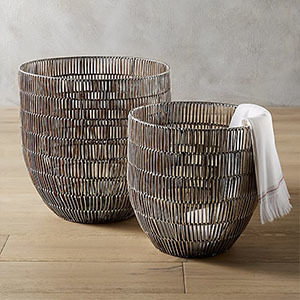 Wicker Baskets Wrapped In An Aluminum Sheet With A Textural Weave. Photo