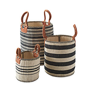 Woven black and tan striped jute storage baskets with leather handles. photo