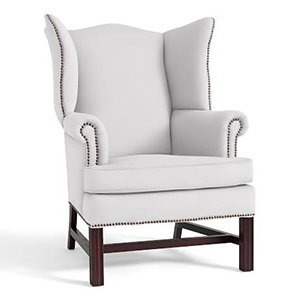 White wingback chair with dark wood legs and small stud details on the side photo