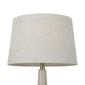 White lampshade with gold crisscross foil pattern photo