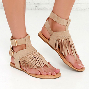 Tan fingle sandals with high buckle strap. photo