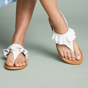 White sandals with ruffle detail. photo