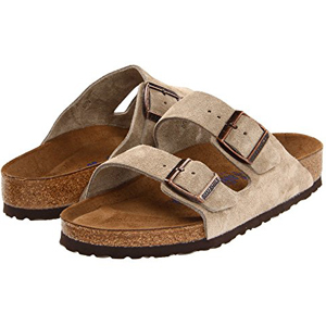 Tan Birkenstock sandals with two buckles. photo