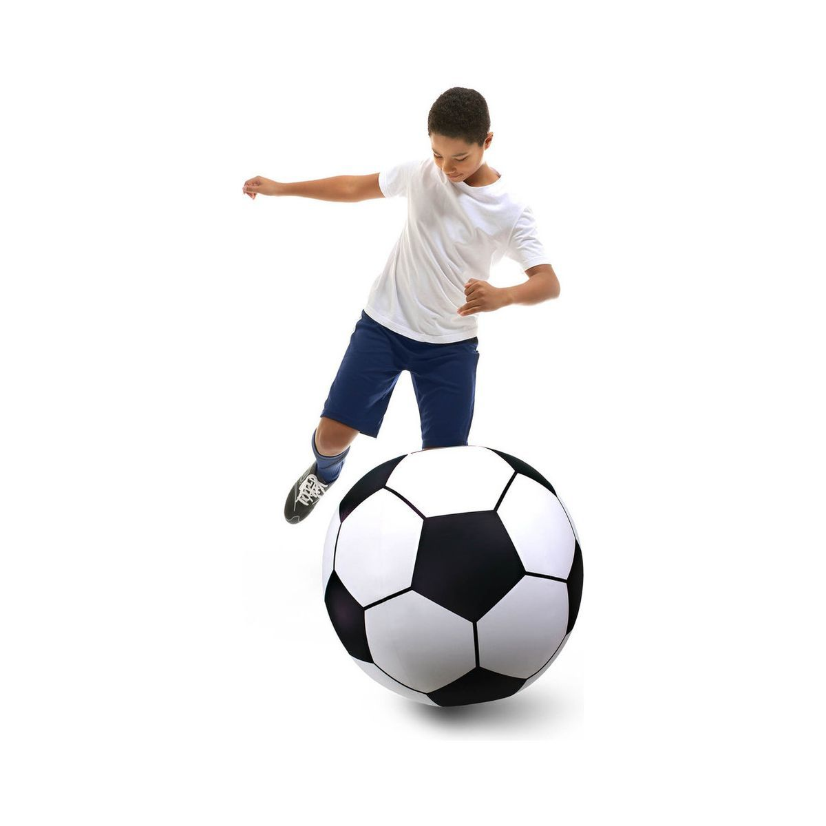 A boy plays with a giant inflatable soccer ball photo