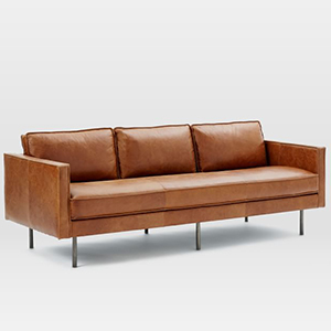 Light brown leather sofa with three back cushions and bronze metal legs photo