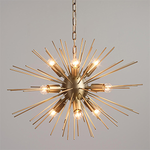 Iron starburst chandelier with a matte brass finish and nine candelabra bulbs photo