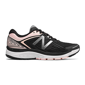 Black and light pink running shoe by New Balance photo