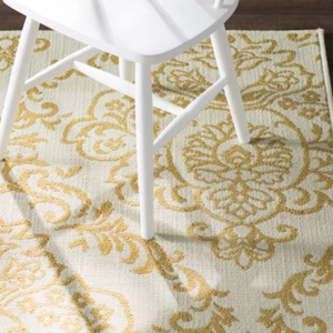 Wayfair ivory and gold patterned outdoor rug photo