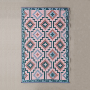 pink and teal rug with geometric pattern photo