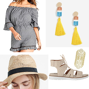 Black and white off the shoulder gingham romper styled with a straw hat, tassel earrings, gold ring, and tan sandals. photo