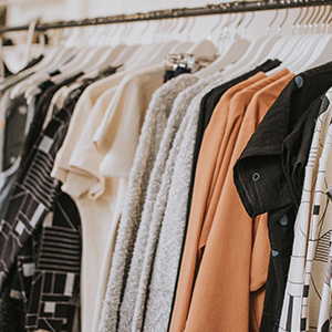 Clothing rack with multiple different shirts on it photo