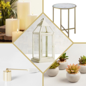 White lantern paired with succulents, candles, a candle snuffer, and a table. photo