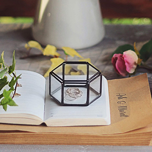 Glass geometric ring box in the shape of a hexagon. photo