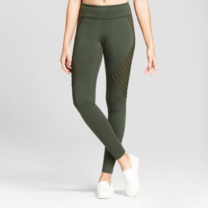 Olive green leggings with textured detail on the sides. photo