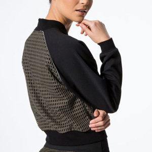 Olive green jacket with checkered print and black sleeves photo
