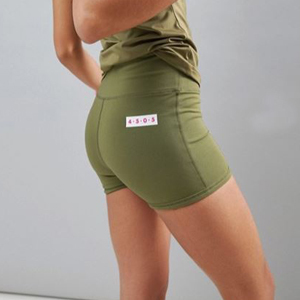 Olive green compression booty shorts. photo