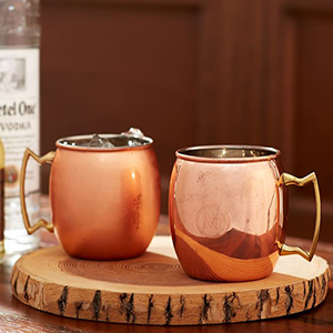 Set of two copper Moscow mule mugs photo