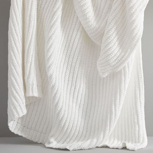 White sweater knit throw from West Elm photo