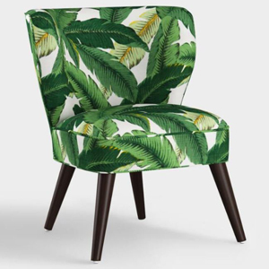 Swaying palm print chair with dark brown legs. photo