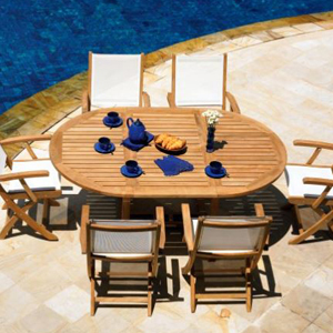 Teak patio dining set that includes a table and white chairs. photo