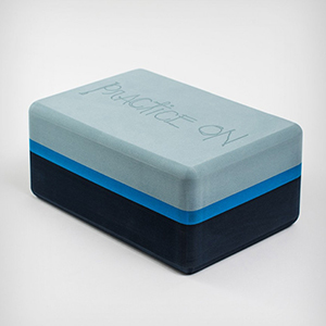 Blue and black yoga block made from recycled foam photo