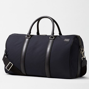 Kate Spade duffel bag with shoulder strap and two handles. photo