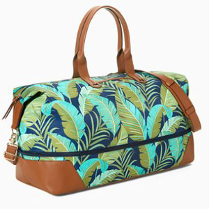 Duffel bag with palm tree print and brown vegan leather trim. photo
