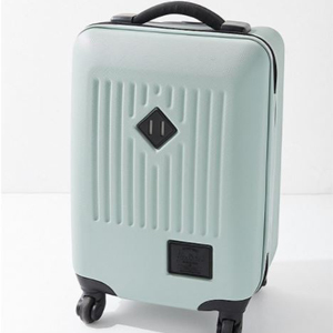 Spinning mint green carry-on bag with black accents and a pull handle. photo