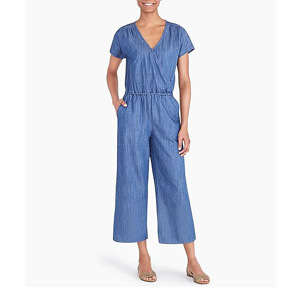 woman wearing a blue chambray jumpsuit with short sleeves photo
